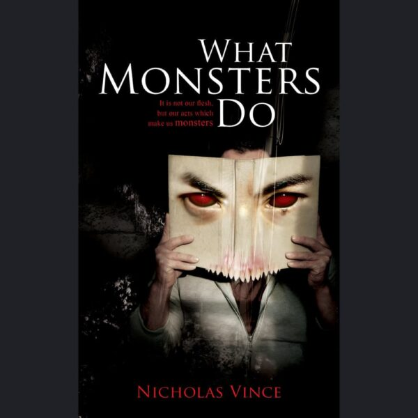 Front cover of What Monsters Do. Man holds book which has red eyes and fanged teeth.