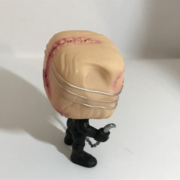 Funko Pop Chatterer out of box, figure's right side also showing top of head.